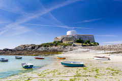 Guernsey beach with fort in background Stock Photo