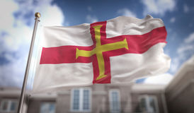 Guernsey Flag 3D Rendering on Blue Sky Building Background Royalty Free Stock Photo