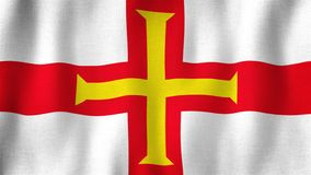 Guernsey flag waving in the wind. Closeup of realistic flag with highly detailed fabric texture