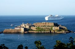 Guernsey St. Peter Port Castle Cornet. View of Castle Cornet and departing cruise liner from St.Peter Port in Guernsey Royalty Free Stock Photography