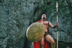 Guerreiro espartano nas madeiras Fotos de Stock Royalty Free