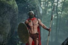 Guerreiro espartano nas madeiras Fotografia de Stock Royalty Free