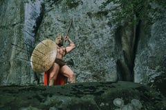 Guerrero espartano en el bosque Imagen de archivo