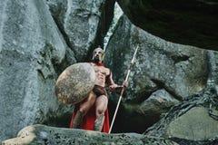Guerrero espartano en el bosque Imágenes de archivo libres de regalías