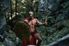 Guerrero espartano en el bosque Imagenes de archivo
