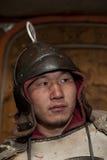 Guerrero mongol en casco Imagen de archivo