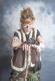 Guerrero tribal femenino joven Foto de archivo libre de regalías