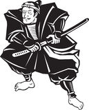 Guerrier de samouraï avec la position de combat d'épée de katana Image stock