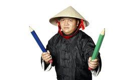 Guerriero asiatico con le grandi matite Fotografia Stock