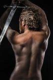 Guerriero con la spada, sogno, rabbia, sognante, uomo coperto in fango, Fotografia Stock Libera da Diritti