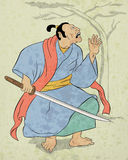Guerriero del samurai con posizione di combattimento della spada di katana Immagine Stock Libera da Diritti