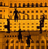 Guerrilla. Six drummers suspended with wires by a crane in front of Parliament House in Bucharest Stock Images