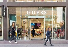 Guess luxury fashion house store entrance with brand signage royalty free stock photography