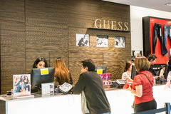 Guess store at Westfield Mall. Customers at the check out counter purchasing clothes on Black Friday, 2014 Royalty Free Stock Photography