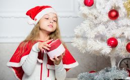 Guess what inside box. Winter holiday tradition. Kid with christmas present. Reason children love christmas. Girl. Celebrate christmas open gift box. Santa royalty free stock images