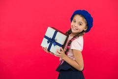 Guess what your child dream about. Best toys and christmas gifts. Kid little girl in beret hat hold gift box. Child stock image