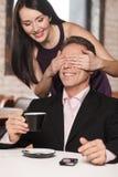 Guess who? Beautiful women closing her boyfriend� eyes while h Stock Photos