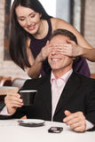 Guess who? Beautiful women closing her boyfriend� eyes while h Stock Photos