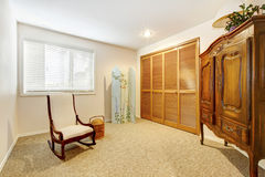 Guest bedroom with large armore and closet door. Stock Photography