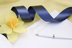 Guest book with blue ribbon Stock Photography