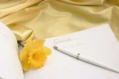 Guest book with daffodil Stock Photos