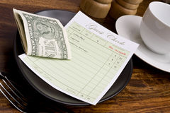 Guest check. With cash in cafe stock photo