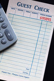 Guest Check and calculator Royalty Free Stock Image