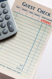 Guest Check and calculator Royalty Free Stock Photo