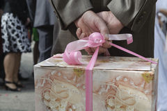 Guest holding wedding present Stock Image