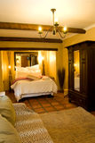Guest house. Bedroom with bed, cupboard and couch Royalty Free Stock Photos