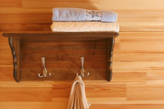 Guest house. Interior. Shelf and towels Royalty Free Stock Photos