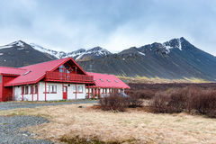 Guest house, Iceland. Guest house with majestic mountain near borganes in Iceland Royalty Free Stock Images
