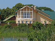 The guest house at the lake Stock Photography