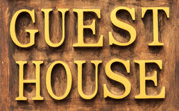 Guest House Sign. On Wood Panel Royalty Free Stock Photography