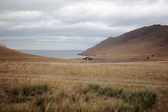 Guest house in Tazheranskaya the steppes near the Baikal lake. Western shore of the lake, a small Bay, HOMESTEAD accommodation, steppe road, cloudy October day Stock Images