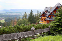 Guest house in the traditional mountain style and mountain. Royalty Free Stock Images