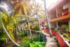 Guest house in tropic. Guest house near the road in tropical greenery village of Kovalam, Kerala, India Stock Images