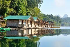 Guest house on water at Rajjaprapha Dam, Thailand Royalty Free Stock Photography