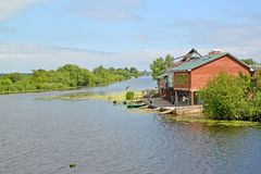 Guest houses with sheds on the river bank of Deyma. Polessk, Kaliningrad region Royalty Free Stock Photos
