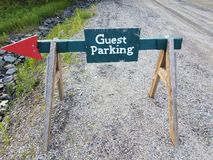 Guest parking sign with red arrow and gravel stock photography