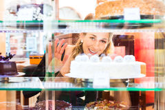 Guest selecting cake from bakery Stock Photos