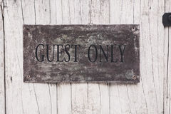 Guest only sign on the wooden door Stock Photography