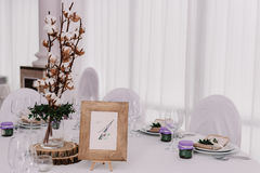 Guest table, with bouquet from cotton and frame with number Stock Image