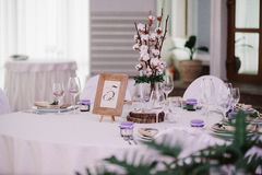 Guest table, with bouquet from cotton and frame with number Royalty Free Stock Images