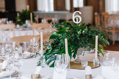 Guest table, with bouquet from petals and a number Stock Images