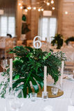 Guest table, with bouquet from petals and a number Royalty Free Stock Image