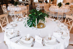 Guest table, with bouquet from petals and a number Stock Photos