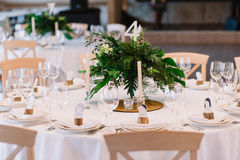 Guest table, with bouquet from petals and a number Royalty Free Stock Photo