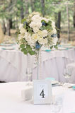 Guest wedding table with number. And bouquet Royalty Free Stock Image