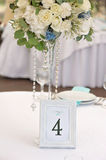 Guest wedding table with number, closeup. Guest wedding table with number and bouquet, closeup Stock Photography